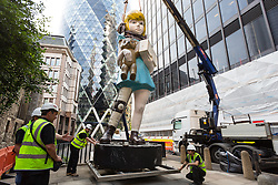© Licensed to London News Pictures. 04/07/2015. London, UK. Damien Hirst's Charity sculpture is installed in the City of London opposite the Gherkin as part of the Sculpture in the City which launches on 9th July. The seven metre high bronze artwork is modelled on The Spastic Society (now called Scope) collection boxes from the 1960's and challenges how perceptions of disability have changed over the years. Photo credit : Vickie Flores/LNP