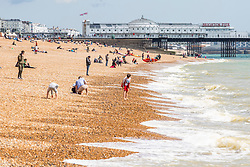 © Licensed to London News Pictures. 12/05/2019. Brighton, UK. Members of the public take advantage of the mild and sunny weather to spend time on the beach in Brighton and Hove. Photo credit: Hugo Michiels/LNP