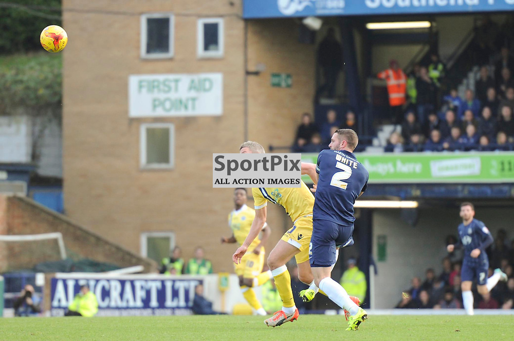 Southends John White and Millwalls Steve Morison in action during the Southend v Millwall game in the Sky Bet League 1 on the 28th December 2015.