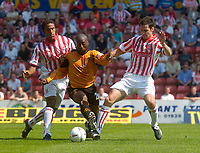 Photo. Glyn Thomas.Digitalsport<br /> Stoke City v Wolverhampton Wanderers. <br /> Coca Cola Championship. 08/08/2004.<br /> Wolves' Dean Sturridge (C) finds a path between Stoke's Darel Russell (L) and Wayne Thomas.