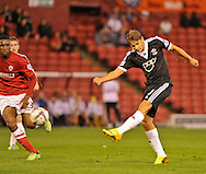 Picture by Richard Land/Focus Images Ltd +44 7713 507003<br /> 27/08/2013<br /> Gaston Ramirez of Southampton tries a long range shot during the Capital One Cup match at Oakwell, Barnsley.