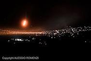 "Syria, Zabadani. Heavy shelling on the restive village of Zabadani. At night Al Assad army shot ""flares"" to localise Free Syrian Army positions on August 8, 2012.  ALESSIO ROMENZI"