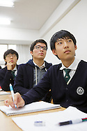 The students Hyung min Shin, Ye jun Seo and Jo Na dan at the Shinil High School, Seoul, South Korea.