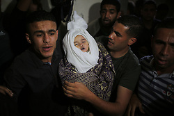 May 5, 2019 - Gaza, Gaza Strip, Palestine - (EDITOR'S NOTE: Image depicts death) Mourners carry the body of 14-month old Palestinian baby Seba Abu Arar carries her body during her funeral in Gaza City May 5, 2019. (Credit Image: © Majdi Fathi/NurPhoto via ZUMA Press)