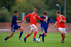NEWPORT, WALES - Sunday, September 24, 2017: Wales' William Rickard and Gibraltar's Kieron Baglietto during an Under-16 International friendly match between Wales and Gibraltar at the Newport Stadium. (Pic by David Rawcliffe/Propaganda)