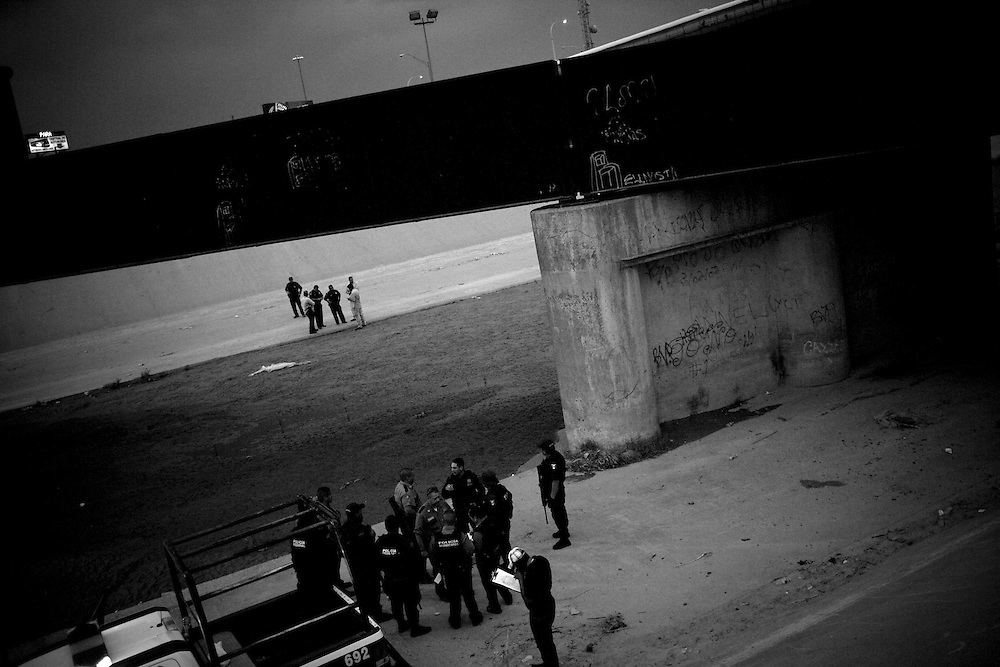 Mexican Police and U.S. Border Patrol at the scene of the murder of a 15 year-old boy, who was killed by a U.S. Border Patrol agent in Ciudad Juarez, Chihuahua on June 7, 2010.