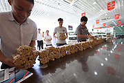 SHENYANG, CHINA - JUNE 02: (CHINA OUT) <br /> <br /> Buying A Car With 660,000 RMB Coins And 20,000 RMB Banknotes In Shenyang<br /> <br /> Staff of an 4S store count coins on June 2, 2015 in Shenyang, China. A buyer from northeast China Shenyang city carried about 660,000 RMB coins and 20,000 RMB banknotes to a car dealer for buying a car. <br /> ©Exclusivepix Media