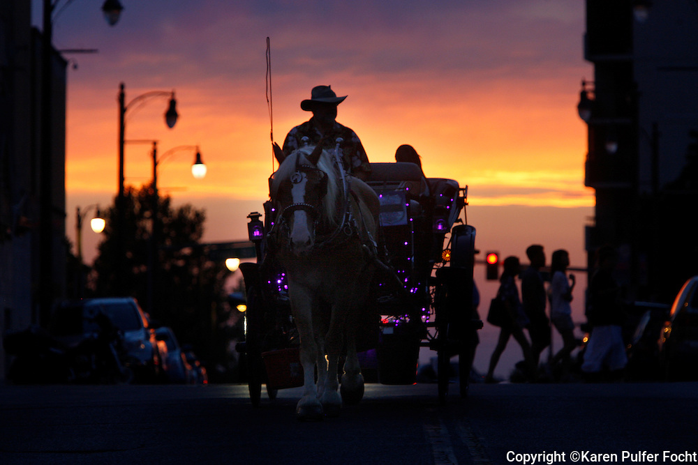 A carriage ride down Beale Street in Memphis, Tennessee. Tourist come to Memphis every August during Elvis Week and flock to Graceland. Beale Street claims to be America's Most Iconic Street, USA Today National Poll, Tennessee's Top Tourism Attraction and The Official Home of the Blues.