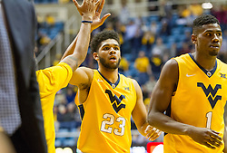 Dec 21, 2015; Morgantown, WV, USA; West Virginia Mountaineers forward Esa Ahmad (23) celebrates with teammates after scoring at the end of the first half against the Eastern Kentucky Colonels at the WVU Coliseum. Mandatory Credit: Ben Queen-USA TODAY Sports