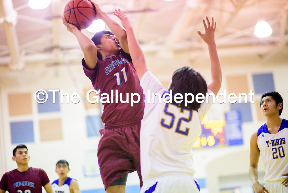 Shiprock ChieftainAndre Joe (11) attempts a shot above  Zuni Thunderbird Chris Hughte (52) at Zuni High School Thursday.