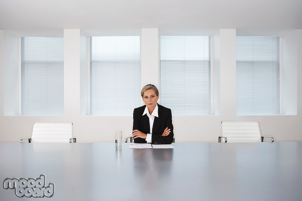 Business Executive Sitting in Boardroom