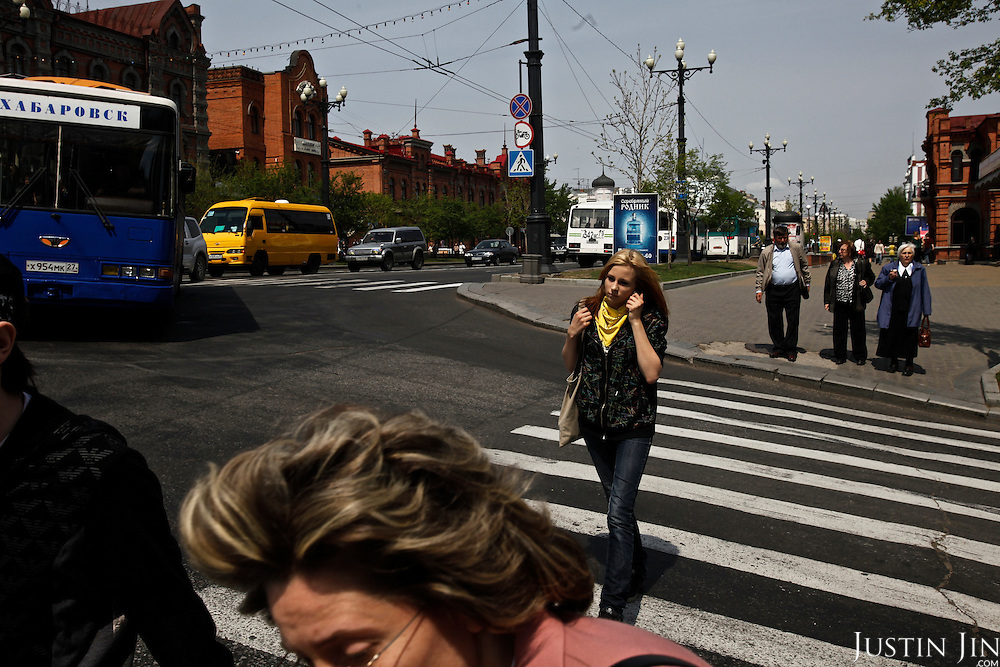 People walk in Khabarovsk city on the bank of the Amur River. The Amur runs along the border separating Russia and China.
