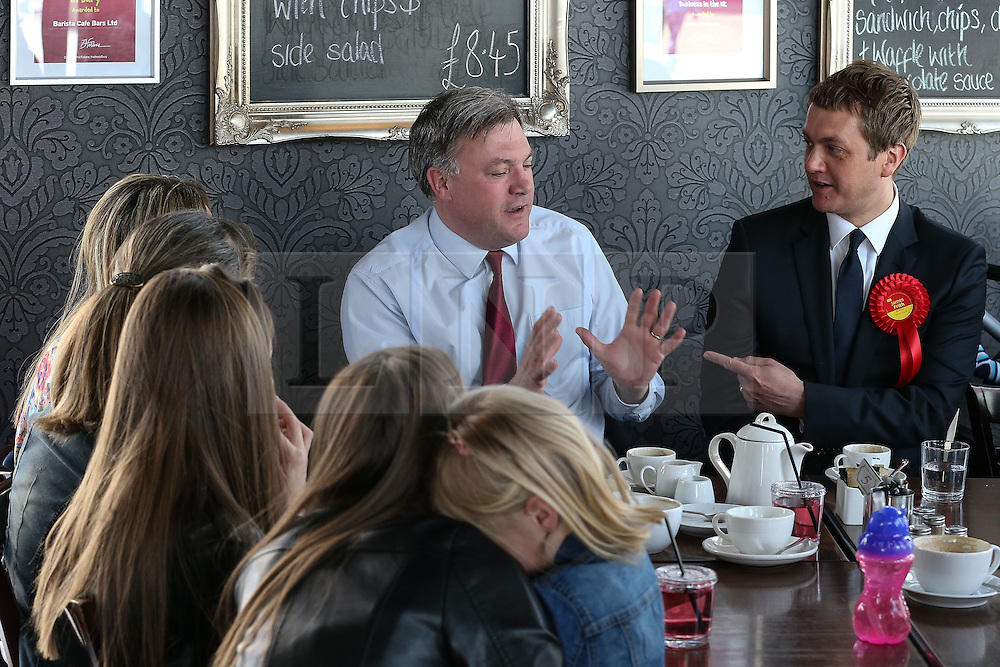 © Licensed to London News Pictures . 11/04/2015 . Bury , UK . Labour Shadow Chancellor Ed Balls (c) and James Frith (r) , Labour candidate for Bury North , at a campaign stop at Barista coffee shop at The Rock , Bury in Greater Manchester , UK . The pair met parents and discussed family finances . Photo credit : Joel Goodman/LNP