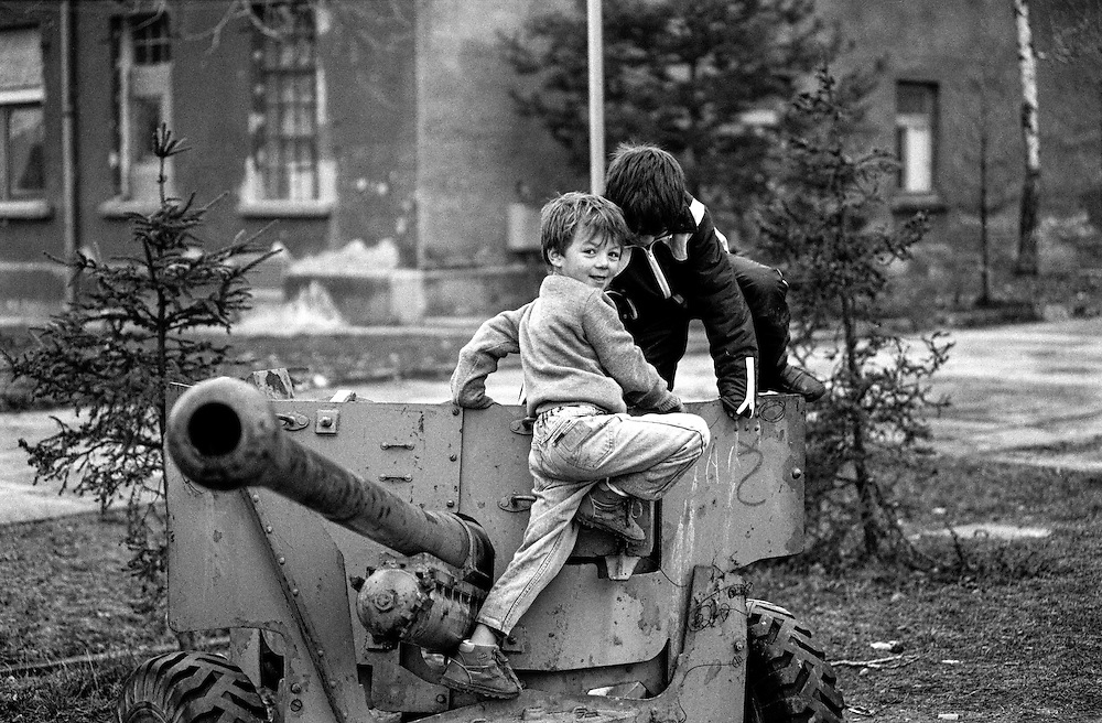 "Child refugees from Bosnia in the Varazdin refugee camp in Croatia in the winter of 1992. The boy on the left is ""Elvis"" who is playing with a friend on a canon."