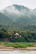 Laos. Luang Prabang. House at the opposite river bank of the Mekong.