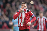Billy Sharp (Captain) (Sheffield United) kisses the Sheffield United badge having scored a penalty to make it 2-0. The goal means the home side are in control of the game during the EFL Sky Bet League 1 match between Sheffield Utd and Bolton Wanderers at Bramall Lane, Sheffield, England on 25 February 2017. Photo by Mark P Doherty.