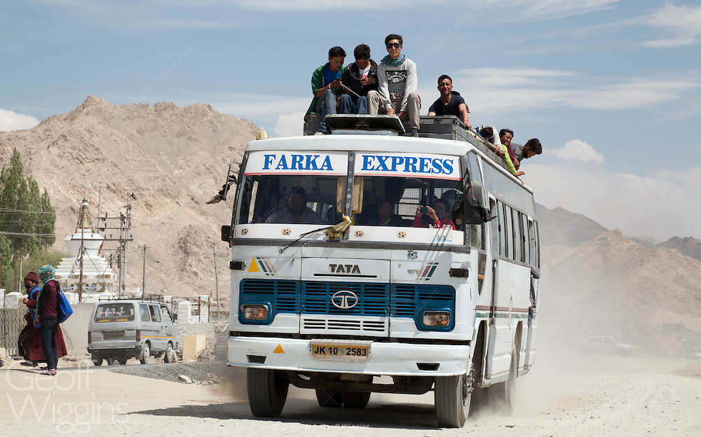 Indian Tata 1512 bus overloaded with passengers and pilgrims returning from the 2014 Kalachakra near Leh, Ladakh., Northern India
