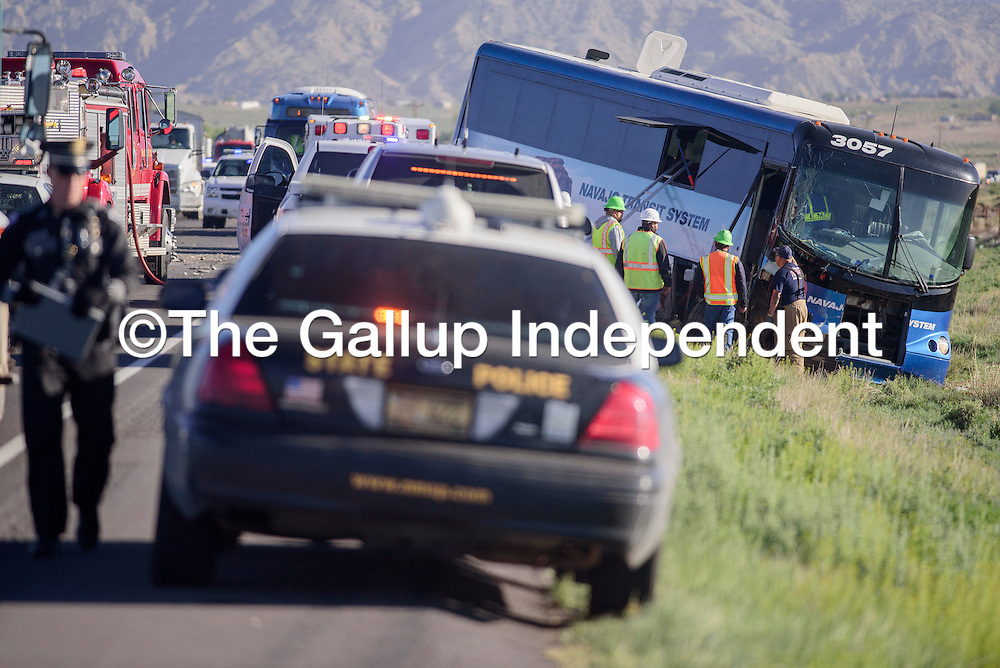 052215       Cable Hoover<br /> <br /> New Mexico State Police and other emergency personnel respond to a Navajo Transit System bus crash on U.S. 491 near Mexican Springs Friday.