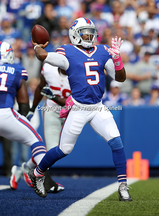 Buffalo Bills quarterback Tyrod Taylor (5) throws a first down pass from his own end zone in the second quarter during the 2015 NFL week 4 regular season football game against the New York Giants on Sunday, Oct. 4, 2015 in Orchard Park, N.Y. The Giants won the game 24-10. (©Paul Anthony Spinelli)