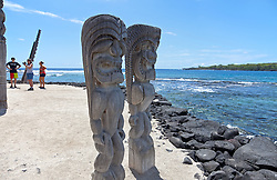 Pu'uhonua o Honaunau National Historial Park - Ki'i in many configurations serve as guardians for one of the park's principal structures, the Hale o Keawe.  Used as a place of refuge and sanctuary in old Hawaii, this park area was the home of Kona District royalty through the reign of Kamehameha II.
