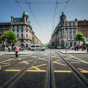 Crossing Abbey Street at the Junction on O'Connell Street over the Tram tracks of the Luas System