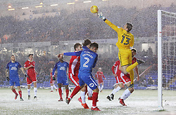 Liam Shephard of Peterborough United challenges with Liam Roberts of Walsall as snow falls - Mandatory by-line: Joe Dent/JMP - 27/02/2018 - FOOTBALL - ABAX Stadium - Peterborough, England - Peterborough United v Walsall - Sky Bet League One