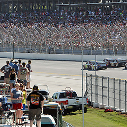 April 17, 2011; Talladega, AL, USA; NASCAR Sprint Cup Series drivers Jeff Gordon (24), Mark Martin (5), Clint Bowyer (33), Kevin Harvick (29), Jimmie Johnson (48) and Dale Earnhardt Jr. (88) make the final turn during the Aarons 499 at Talladega Superspeedway.   Mandatory Credit: Derick E. Hingle