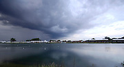 Eton, GREAT BRITAIN, Large rain clouds loom over Dorney lake during the opening ceremony for the  2006 World Rowing Championships, 19/08/2006.  Photo  Peter Spurrier, © Intersport Images,  Tel +44 [0] 7973 819 551,  email images@intersport-images.com Rowing Course, Dorney Lake Sunrise, Sunsets, Silhouettes
