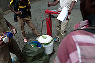 Guides and porters stand by the weighing scale at the Machame Gate of Mount Kilimanjaro. The national park in Tanzania has mandated that no porter may carry more than 20kg on their backs, and requires all packs and bundles to not only be weighed before the start, but also at the end of the first day of trekking.