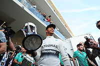 Race winner Lewis Hamilton (GBR) Mercedes AMG F1 celebrates with the team.<br /> United States Grand Prix, Sunday 2nd November 2014. Circuit of the Americas, Austin, Texas, USA.