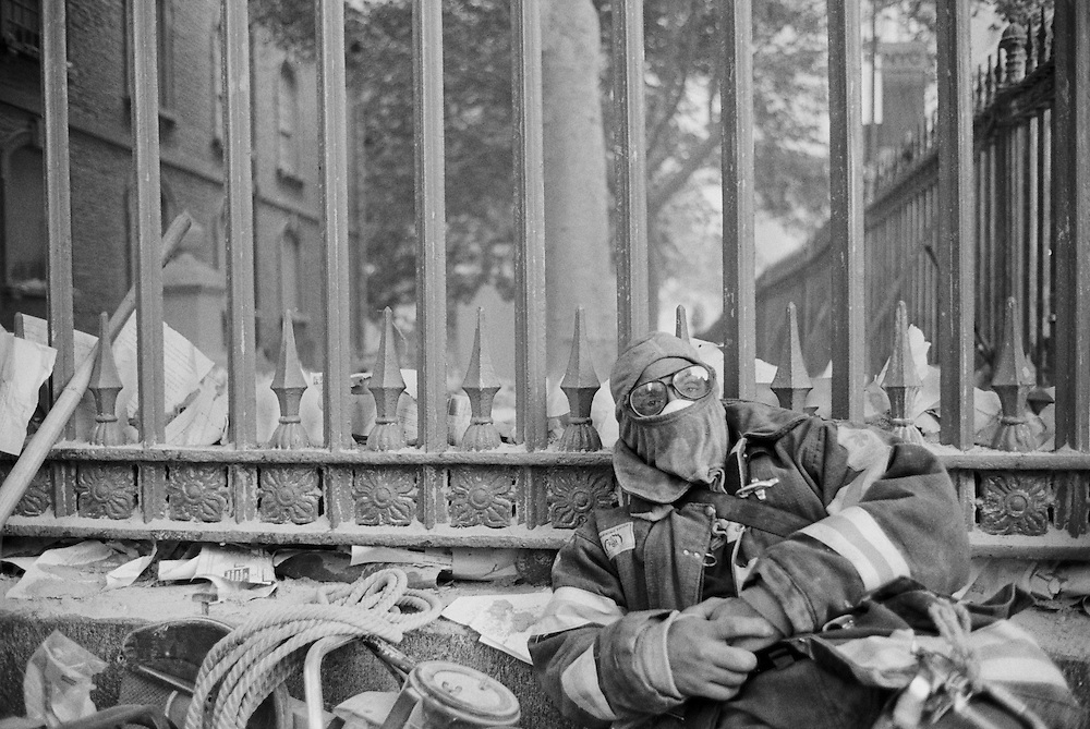 Exhausted fireman outside St. Paul's church near the collapsed World Trade Center.  11 Sept. 2001