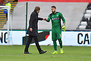 Swansea City manager Graham Potter congratulates goalkeeper Kristoffer Nordfeldt (1) of Swansea City at full time after his team won 2-0 during the EFL Sky Bet Championship match between Swansea City and Reading at the Liberty Stadium, Swansea, Wales on 27 October 2018.