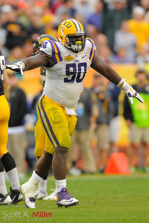 LSU Tigers defensive tackle Anthony Johnson (90) celebrates during LSU's 21-14 win over the Iowa Hawkeyes in the 2014 Outback Bowl at Raymond James Stadium on Jan 1, 2014  in Tampa, Florida.            ©2014 Scott A. Miller