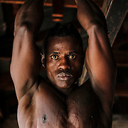Yomi Shokunbi, a Nigerian living in South Africa, at the Hillbrow Boxing Club. Currently working as a model and fitness trainer, he hopes to qualify for his boxing license in a few weeks time and become a professional heavyweight boxer.