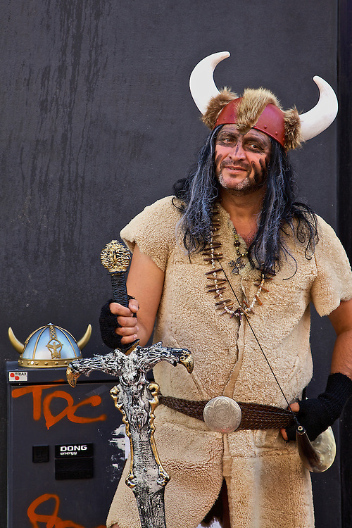 A crowd pleaser playing to tourists is decked out in Viking attire on the streets of Copenhagen, Denmark