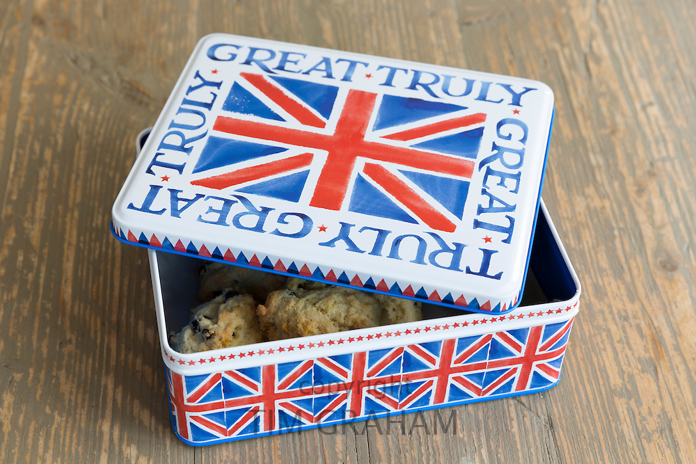 Traditional English home-made sweet rock cakes buns in cake tin with Union Jack flag design