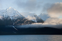 Morning light breaks through the clouds. Photo taken from the Juneau to Haines Ferry.