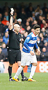 Queens Park Rangers midfielder Alejandro Faurlín receives a yellow card during the Sky Bet Championship match between Queens Park Rangers and Ipswich Town at the Loftus Road Stadium, London, England on 6 February 2016. Photo by Andy Walter.