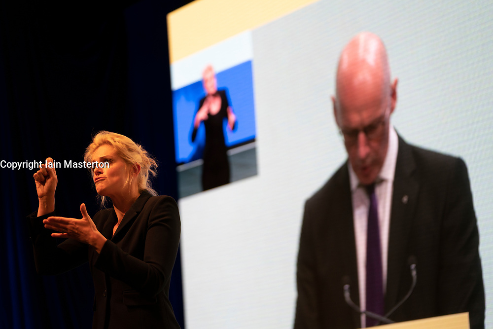 Edinburgh, Scotland, UK. 27 April, 2019. SNP ( Scottish National Party) Spring Conference takes place at the EICC ( Edinburgh International Conference Centre) in Edinburgh. Pictured; Woman signing for the deaf as Deputy First Minister John Swinney makes his address on Day 1 of the conference