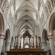 The top of the altar and roof of the nave at the Cathedral of St. Michael and St. Gudula (in French, Co-Cathédrale collégiale des Ss-Michel et Gudule). A church was founded on this site in the 11th century but the current building dates to the 13th to 15th centuries. The Roman Catholic cathedral is the venue for many state functions such as coronations, royal weddings, and state funerals. It has two patron saints, St Michael and St Gudula, both of whom are also the patron saints of Brussels.