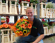 Violets are blue, roses are....how much!<br /> <br /> An online florist has unveiled this year's most extravagant Valentine's bouquet – a bunch of roses costing £10,000.<br />  <br /> These are not just any roses, however. They are grown 2,800 metres above sea level amid the mountains of Ecuador and stand five feet tall.<br />  <br /> For £10,000, you get 1,000 of the blooms, each one with an average of 60 petals that are renowned for their soft, velvety, rounded appearance. <br />  <br /> For good measure, ArenaFlowers.com, the online florist selling the giant-sized bouquet, throws in an iPad and bottle of Louis Roederer Cristal champagne.<br />  <br /> The flowers are part of a range of gifts for Valentine's Day called One of a Kind which launches today.<br /> <br /> Photo shows Area's co owner Will Wynne<br /> ©Exclusivepix Media
