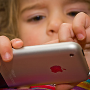 A child uses her father's brand new iPhone at age 3 in Eagle, Colorado.