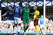 Everton goalkeeper Jordan Pickford (1) separates Everton defender Yerry Mina (13) and Watford midfielder Roberto Pereyra (37) as they square up to each other during the Premier League match between Everton and Watford at Goodison Park, Liverpool, England on 17 August 2019.