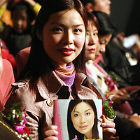 "BEIJING, 18 DECEMBER 2004: Yang Yuan, a would-be model who was disqualified from a model pageant earlier on this year, shows her biography  at  the ""first worldwide artificial beauty pageant ""  in a theatre in Beijing, 18 December , 2003, in China...Beauty business in China , from cosmetic surgeries to hair brush sales, has amounted to more than USD 7 billion in 2003. The contest for women who have undetgone plastic surgery was organized after Yang Yuan, a young would-be model, was disqualified earlier on this year when organizers discovered that she'd had plastic surgery. Yang was present during the contest to introduce her biography that explains why she has the right to ""improve"" her natural features... .."