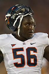 September 11, 2010; Los Angeles, CA, USA;  Virginia Cavaliers defensive end Cam Johnson (56) warms up before the game against the Southern California Trojans at the Los Angeles Memorial Coliseum. USC defeated Virginia 17-14.