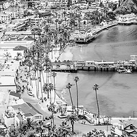 Catalina Island Avalon waterfront aerial black and white photo. Picture includes Avalon Bay, Avalon seaside buildings, and the Green Pleasure Pier. Catalina Island is a popular travel destination off the coast of Southern California in the United States.