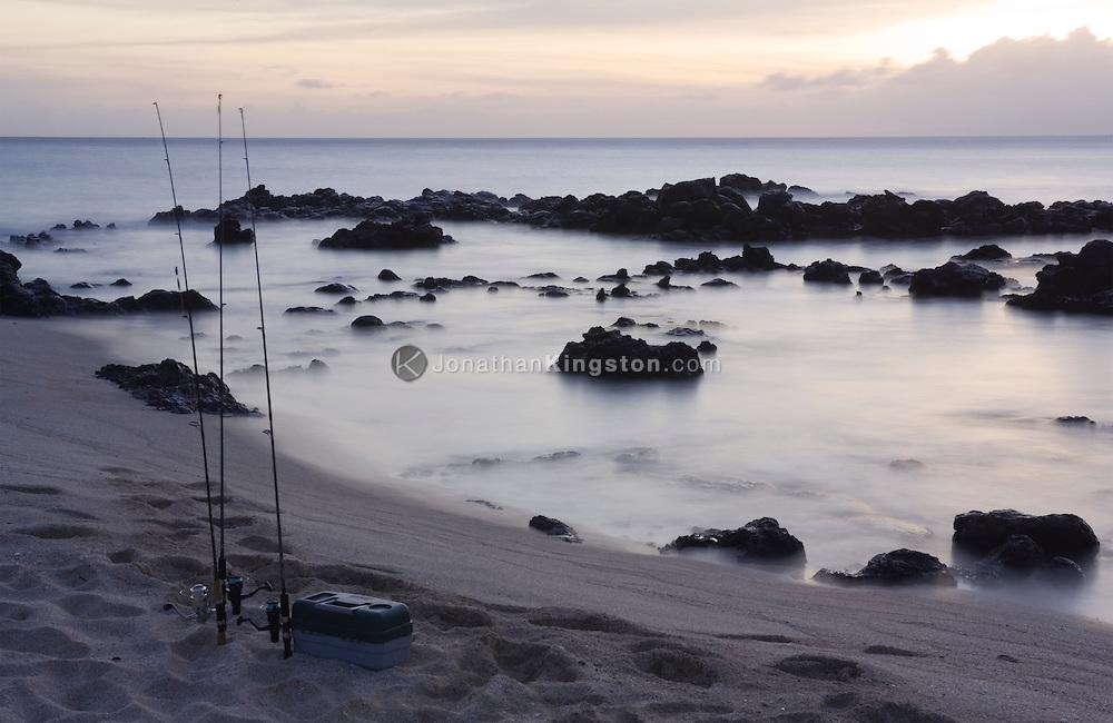 MOLOKAI, HI - Fishing rods on the beach at Kaupoa Bay on the Pacific island of Molokai, Hawaii.