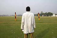 It's polo season in India, and an Indian polo official waits patiently for the riders to score a goal  at the Jaipur Polo Ground in New Delhi, India Sunday Nov. 10, 2002. Invented in South Asia hundreds of years ago, and refined by generations of colonial English cavalrymen, Indian polo had largely disappeared by the 1980s,in the past few years, polo has found new patrons in the magnates who have emerged since India opened up its economy. Elizabeth Dalziel