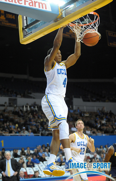 Dec 20, 2011; Los Angeles, CA, USA; UCLA Bruins guard Norman Powell (4) dunks the ball against the UC Irvine Anteaters at the Los Angeles Memorial Sports Arena. UCLA defeated UC Irvine 89-60.