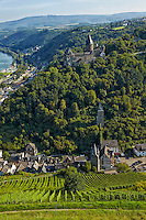 Romantic Rhine view of Stahleck Castle, Rhine River, vineyards, and rolling hills, Bacharach, Germany.
